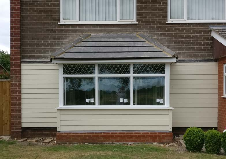 Timber framed porch extensions